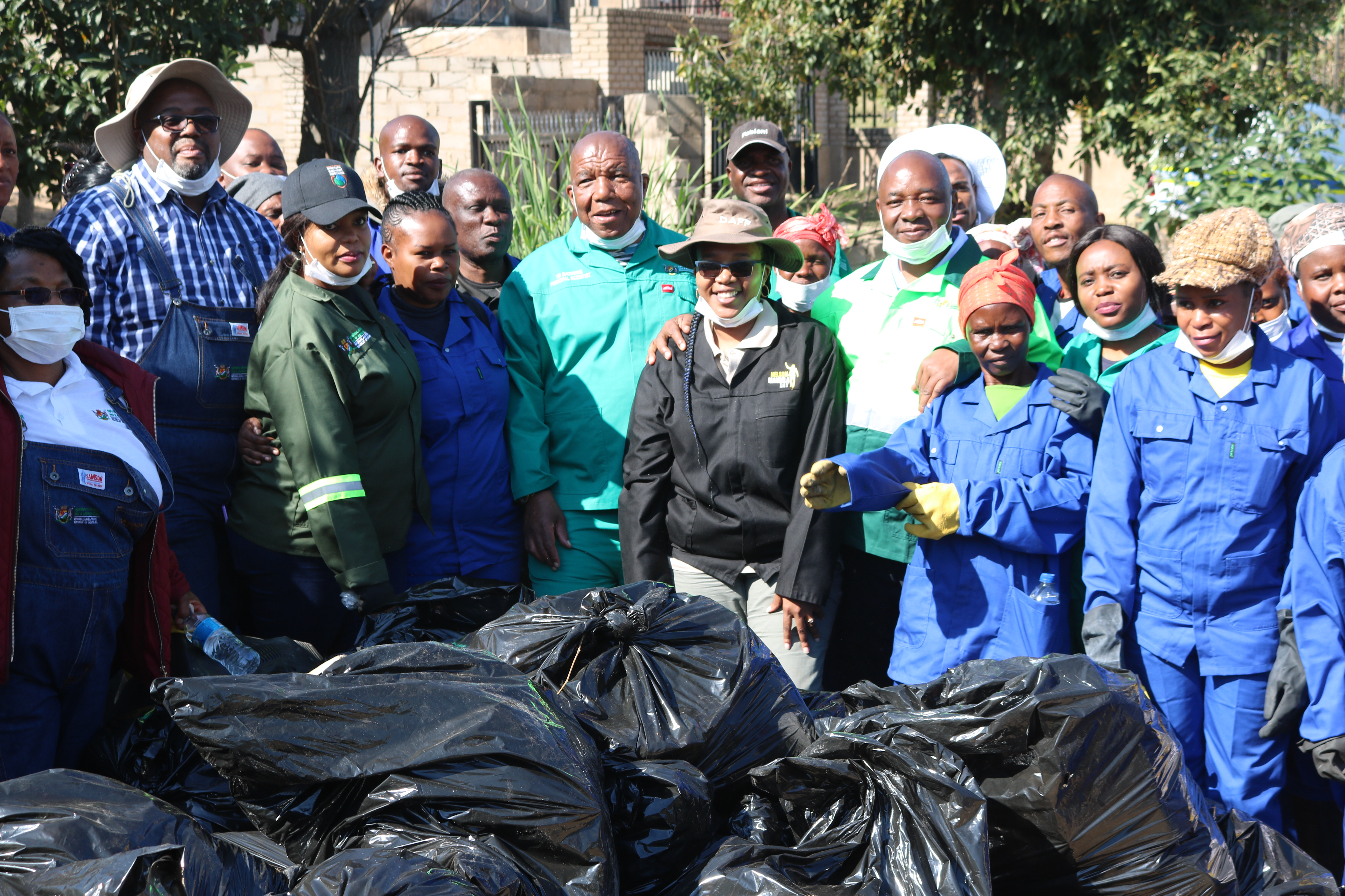 MEC VR Shongwe and HOD Lucky Monareng in a group picture with the collected waste